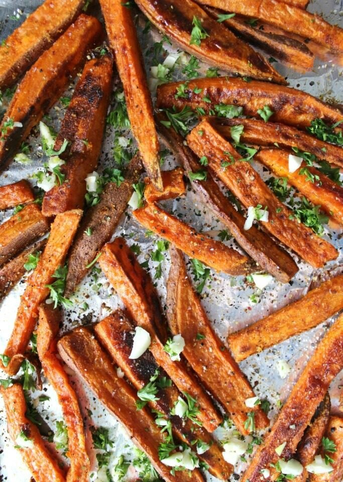 These Baked Garlic Sweet Potato Fries are a guilt free treat | VEGAN + GF | ThisSavoryVegan.com