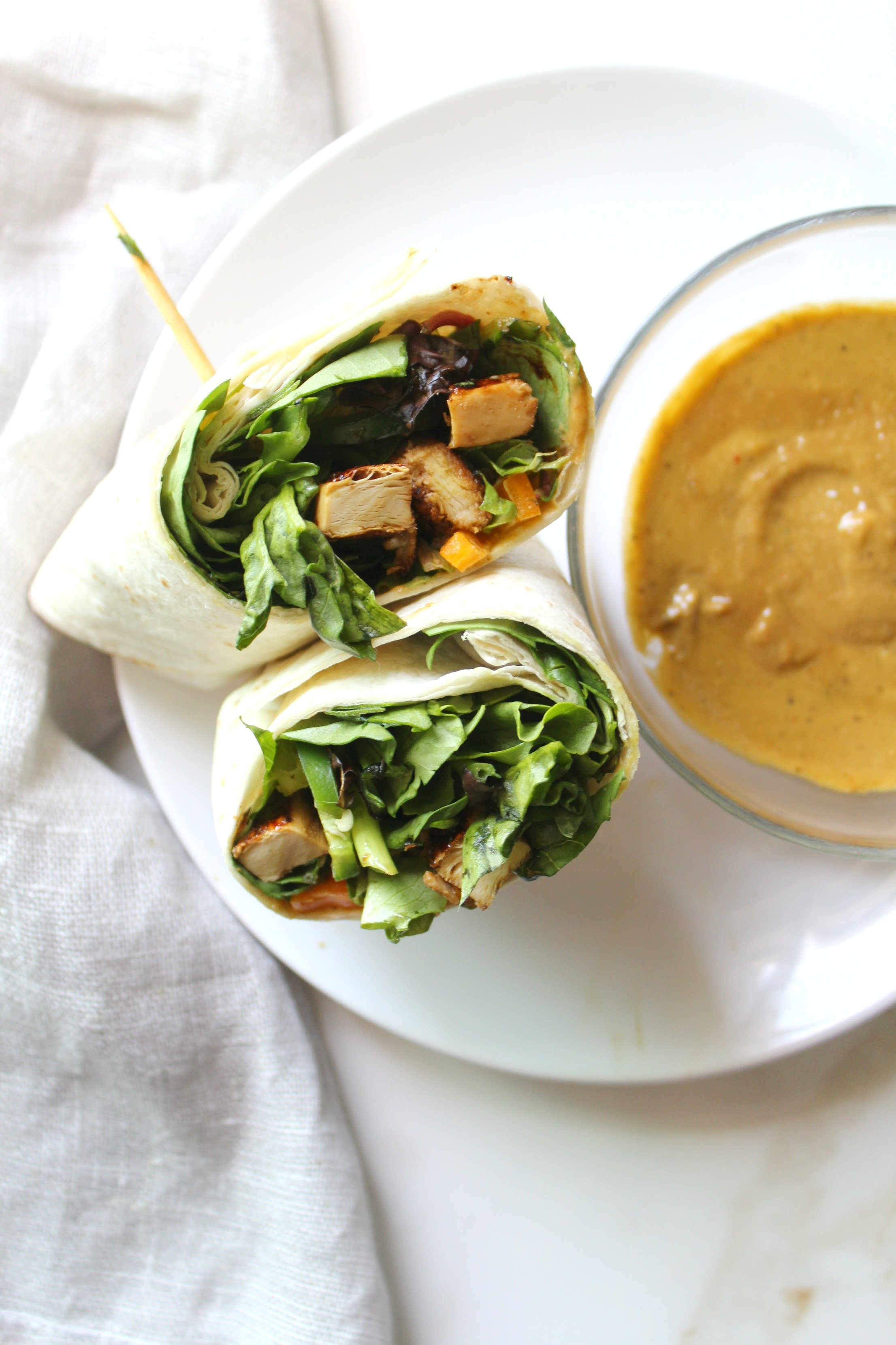 This Asian Chick'n Wrap with Spicy Tahini Sauce is an easy VEGAN lunch   ThisSavoryVegan.com