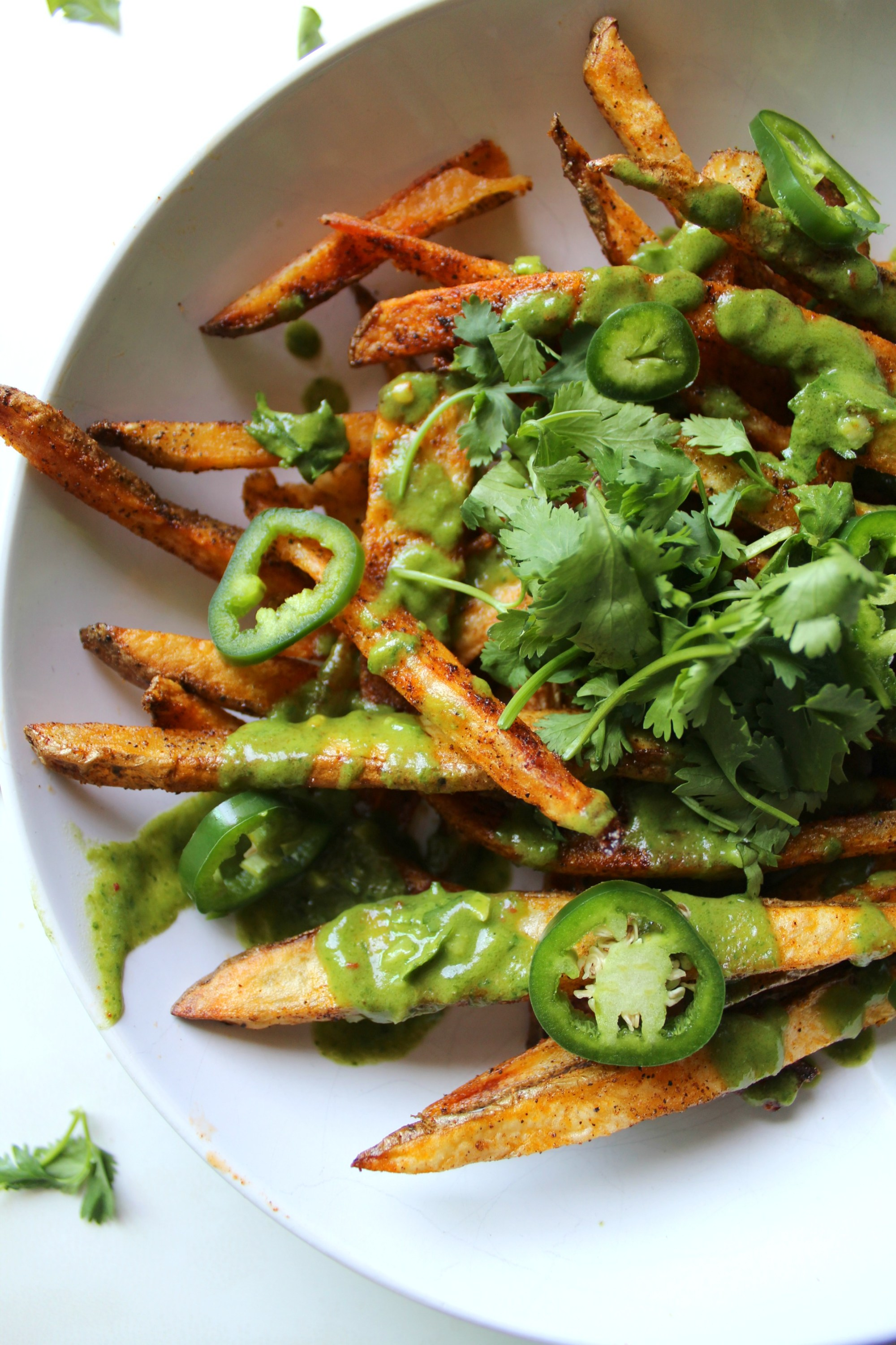 These Loaded Baked Fries with Cilantro Lime Dressing are the perfect snack   VEGAN + GF   ThisSavoryVegan.com