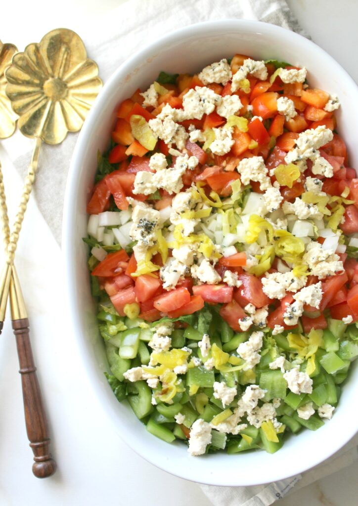 This Chopped Salad with Tofu Feta combines tons of veggies with a tangy dressing and faux feta   VEGAN + GF   ThisSavoryVegan.com