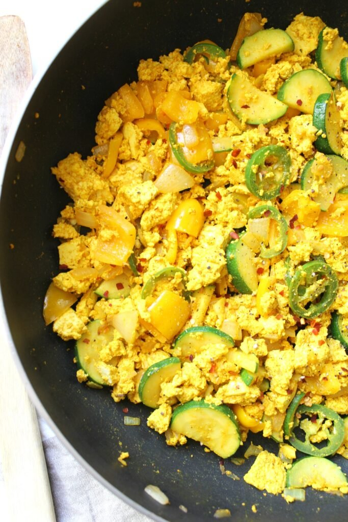 """This Tofu Veggie Scramble is the perfect healthy breakfast - veggies are sautéed with protein packed tofu and the """"miracle"""" seasoning turmeric 