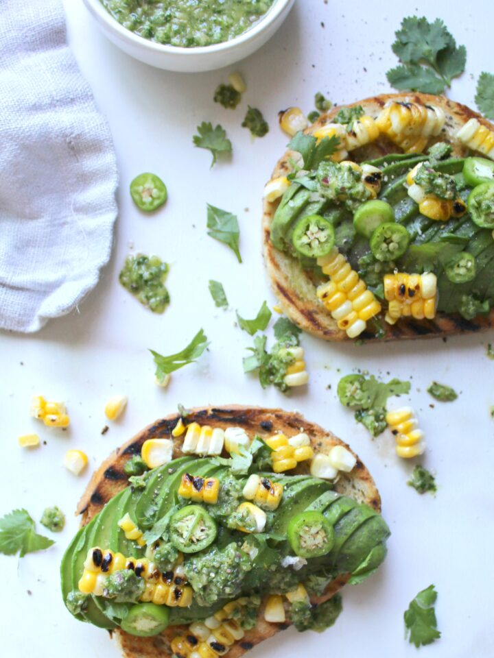 Spice up your next brunch with this Serrano Pepper Avocado Toast - packed full of flavor with grilled corn and fresh chimichurri sauce   ThisSavoryVegan.com
