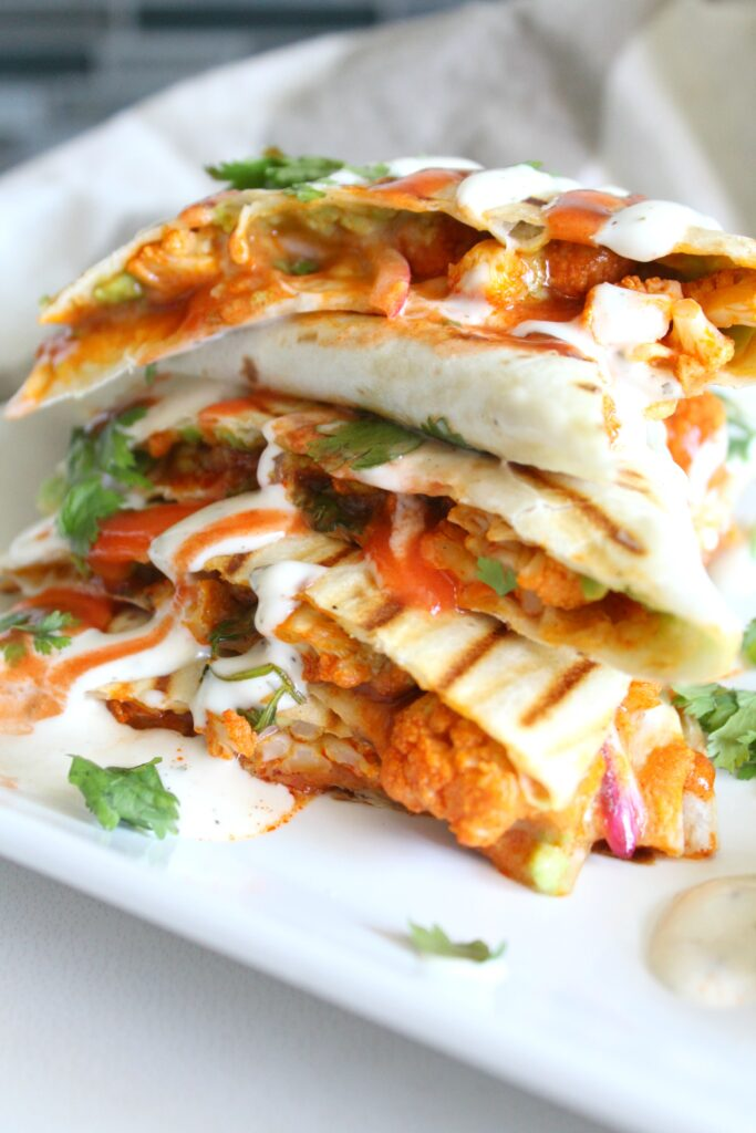 Spice up your next lunch with thisVegan Buffalo Cauliflower Quesadillas. A creamy, spicy combo of marinated cauliflower, vegan ranch and buffalo sauce | ThisSavoryVegan.com