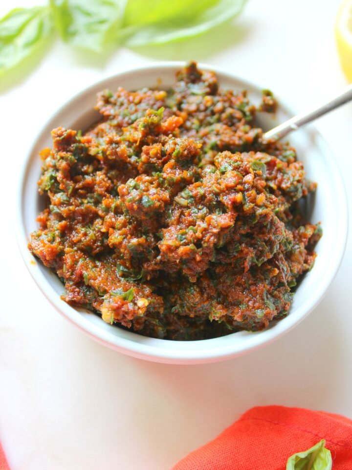 This Vegan Sun-Dried Tomato Pesto is a simple and savory sauce that can be used in sandwiches, over pasta or as a dip | ThisSavoryVegan.com