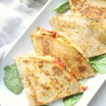 A quick and easy snack or dinner - these Simple Vegan Hummus Quesadillas are packed full of healthy mediterranean flavors. Ready in just 10 minutes!   ThisSavoryVegan.com