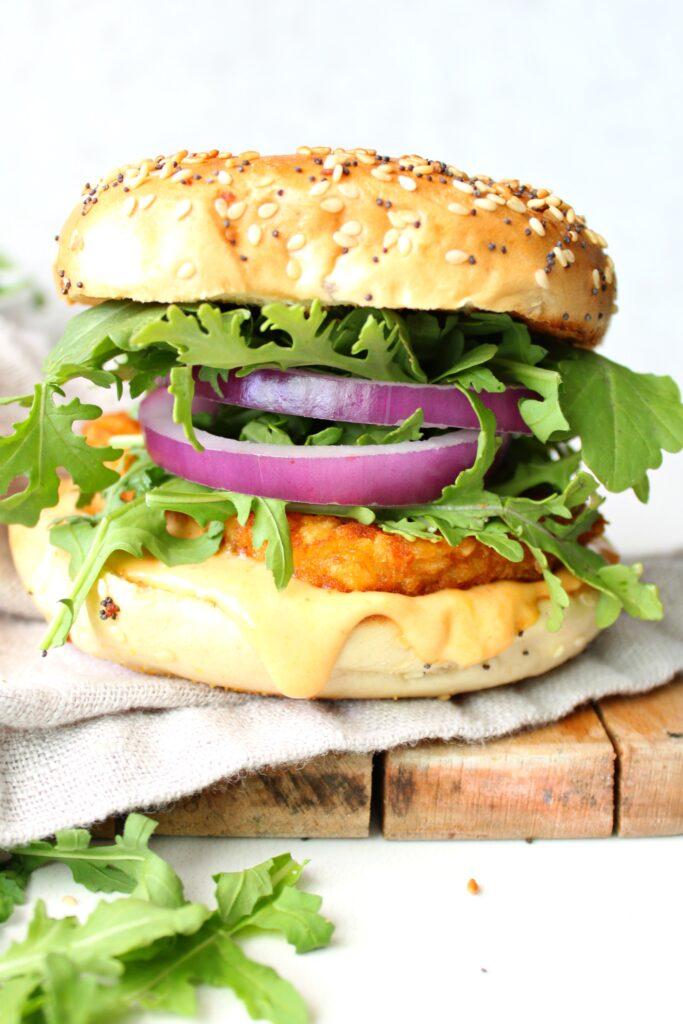 Switch up your typical breakfast with thisHash Brown Breakfast Bagel with Vegan Sriracha Mayo. A crunchy, spicy twist on a breakfast sandwich   ThisSavoryVegan.com #vegan #veganbreakfast