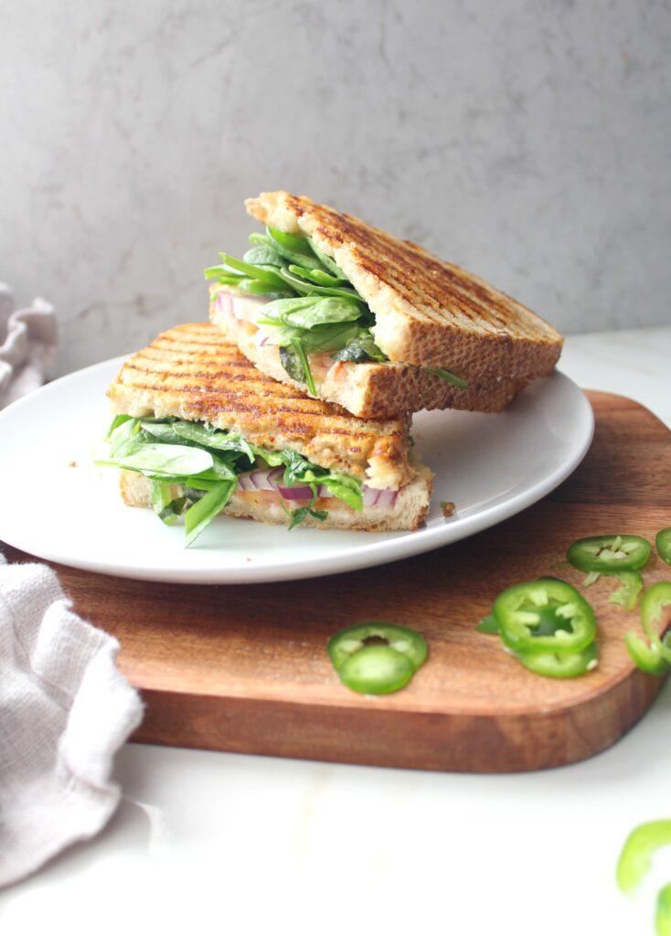 ThisVegan California Panini is packed full of avocado, red onion, tomato, jalapeño, cilantro, spinach and vegan cream cheese | ThisSavoryVegan.com #vegan #simplevegan
