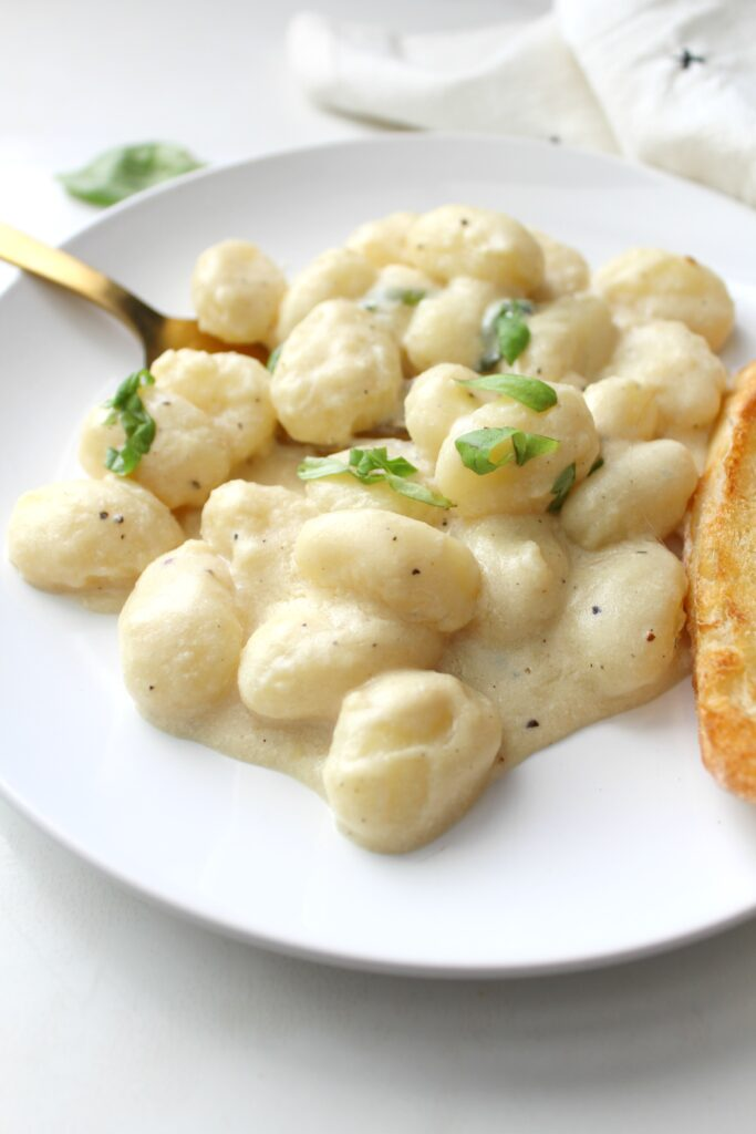 ThisCreamy White Wine Vegan Gnocchi is a rich and simple meal that will have you coming back for more. Ready in just 20 minutes! | ThisSavoryVegan.com #vegan #plantbased #pasta