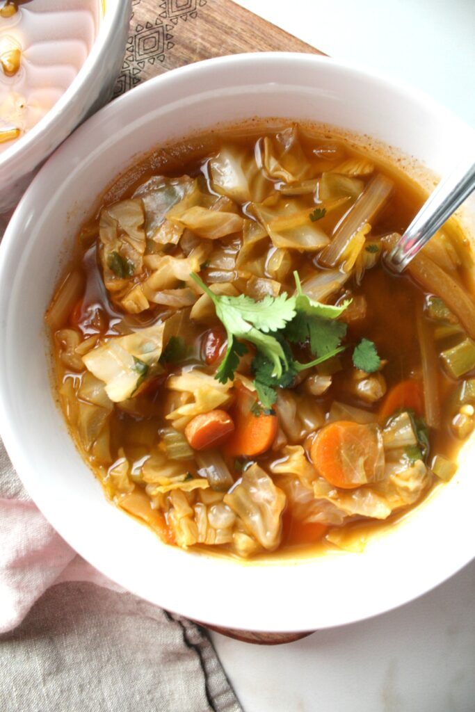 Perfect for those cold winter days, thisSpicy Cabbage Detox Soup is packed full of veggies, spices and a delicious vegan beef broth   ThisSavoryVegan.com #vegan #vegansoup