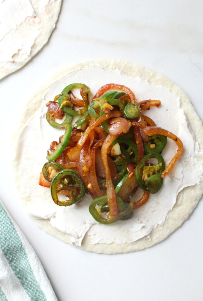 The simple way to get all of the flavors of jalapeño poppers with minimal work. TheseVegan Jalapeño Popper Quesadillas are creamy, crunchy and a little spicy   ThisSavoryVegan.com #vegan #gameday