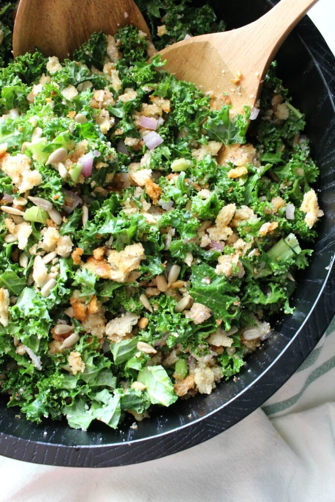 ThisToasted Breadcrumb and Vegan Parmesan Kale Salad is what kale salads should always be. Ready in 30 minutes and tossed in a light lemonvinaigrette, this is the perfect side salad for any time of year | ThisSavoryVegan.com
