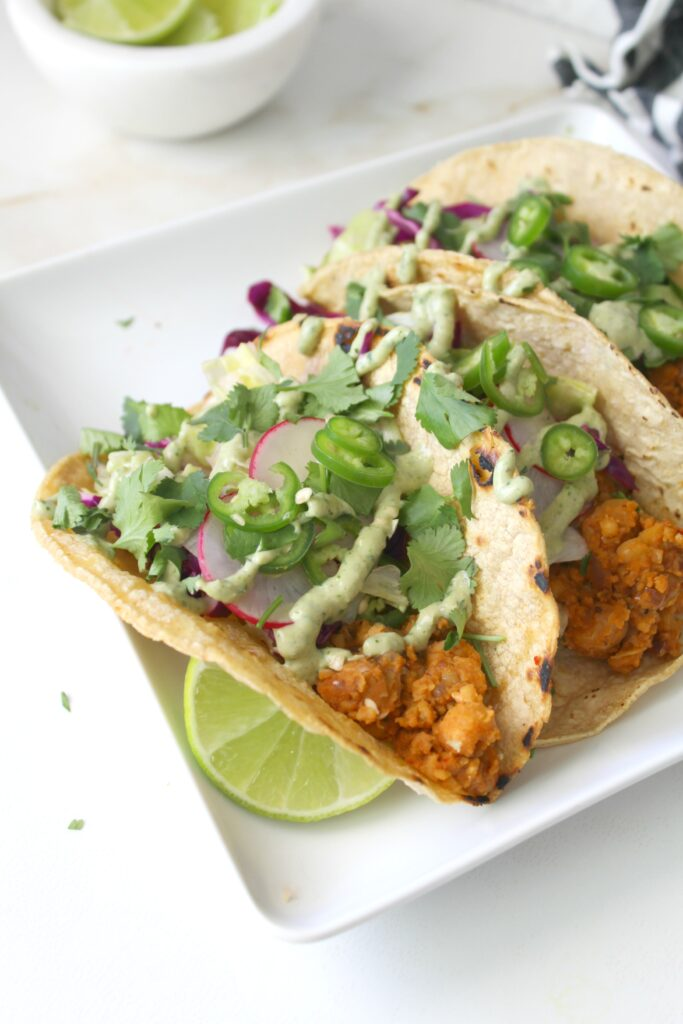 TheseSmashed Chickpea Tacos with Vegan Jalapeño Cream Sauce are the perfect blend of seasoned chickpeas, fresh slaw and a bit of spice! Taco Tuesday never looked so good   ThisSavoryVegan.com #tacotuesday #vegan