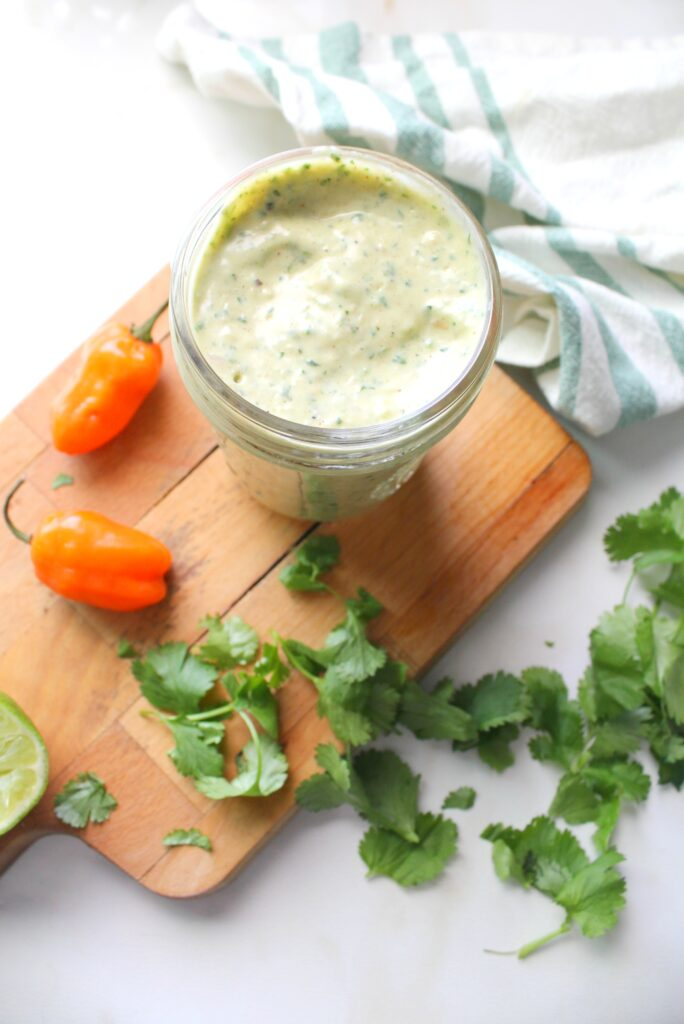 ThisVegan Habanero Cream Sauce is the perfect spicy topper for salads, tacos, burritos and bowls. This sauce is nut-free and seasoned to perfection   ThisSavoryVegan.com #thissavoryvegan #spicy #dressing