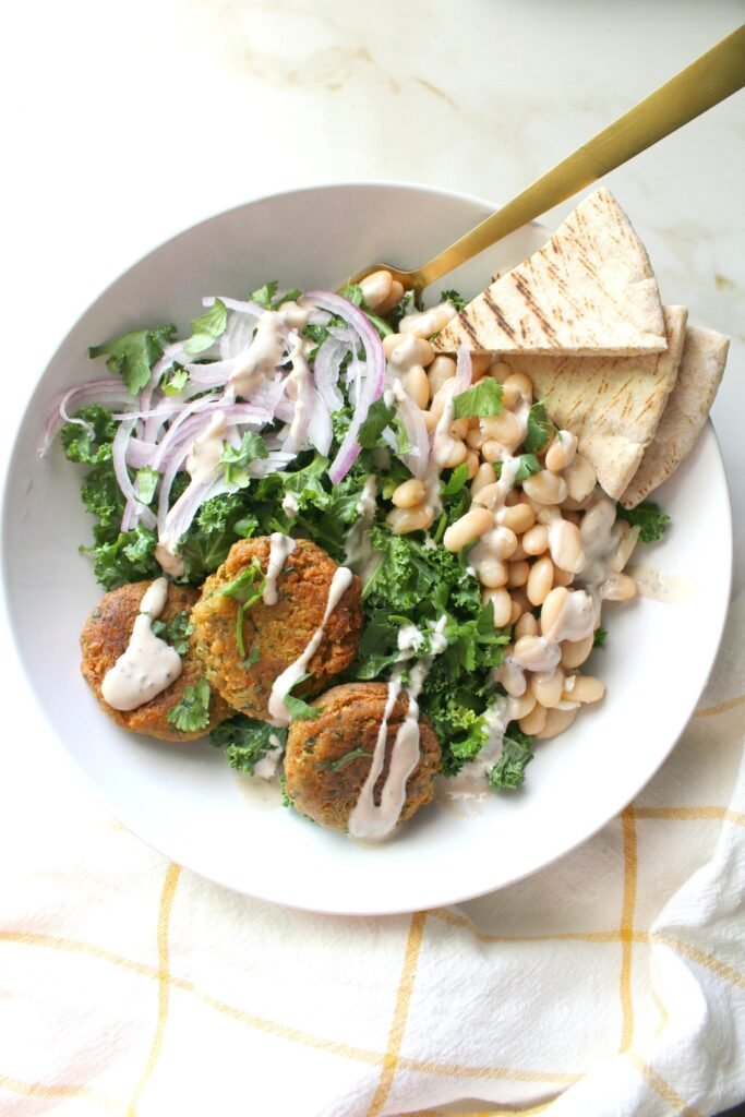 ThisFalafel Kale Salad with The Best Tahini Dressing is going to be your new go-to meal. Filled with healthy veggies, great flavors and a creamy oil-free dressing that is delish   ThisSavoryVegan.com #thissavoryvegan #healthy #salad