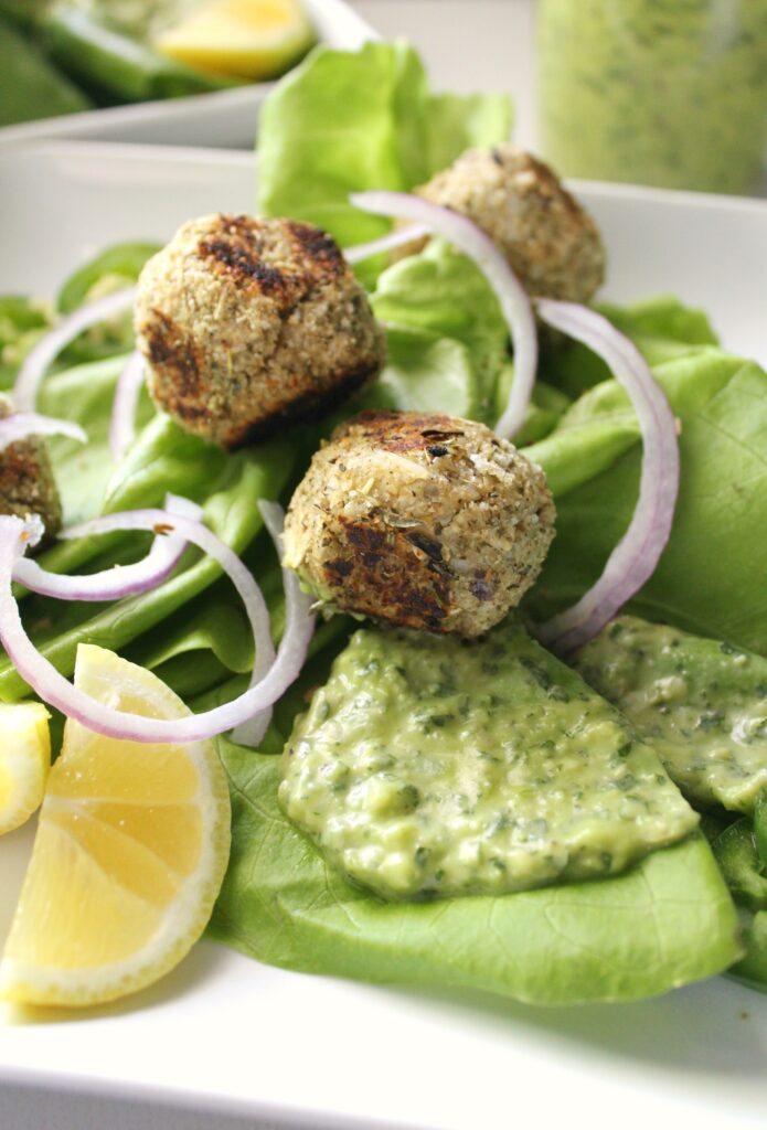 Salads got a whole lot tastier with thisVegan Meatball Salad with Creamy Dreamy Green Sauce. Packed full of butter lettuce, cauliflower meatballs, red onions, jalapeños and the BEST green dressing   ThisSavoryVegan.com #thissavoryvegan #mealprep #healthyrecipe