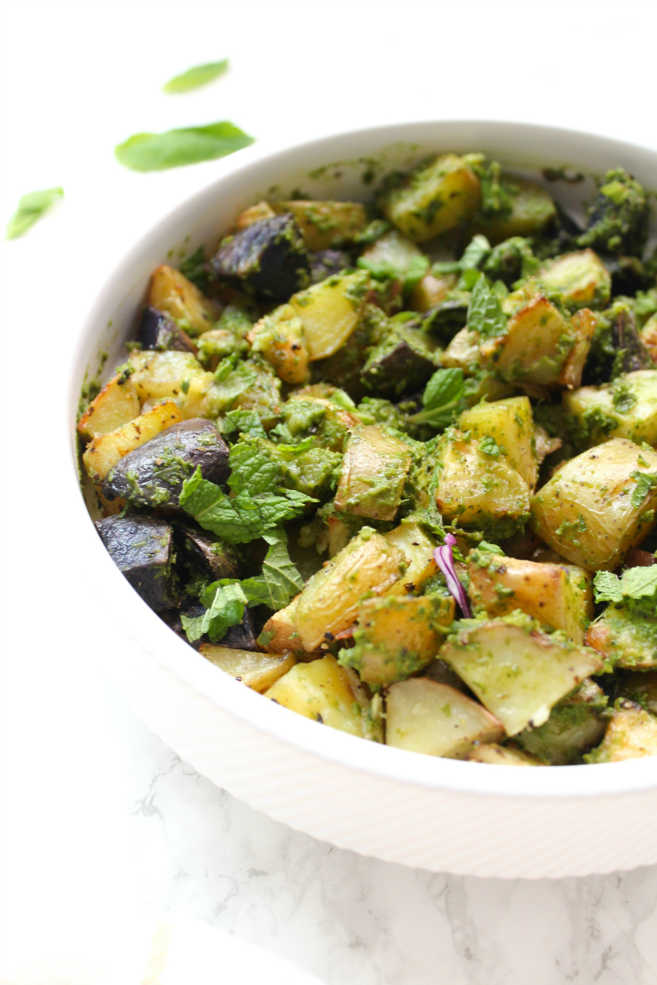 TheseRoasted Garlic and Pesto Potatoes are loaded with tons of fresh herbs - the perfect side dish for any time of year | ThisSavoryVegan.com #thissavoryvegan #potatoes #vegansidedish