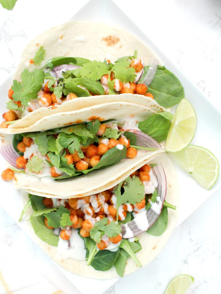 A 20 minute dinner that will have you going back for seconds - these Buffalo Chickpea Tacos with Vegan Ranch are simple & delicious | ThisSavoryVegan.com #thissavoryvegan #buffalotacos #tacotuesday