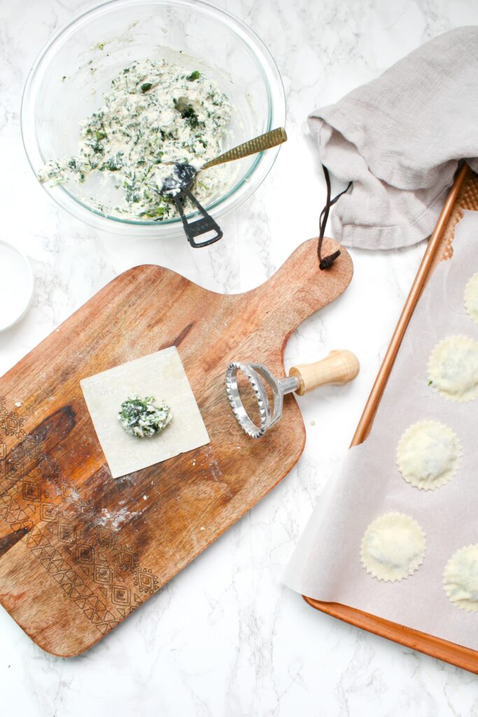TheseSpinach Ricotta Vegan Ravioli are made easy by using pre-made wonton wrappers in place of pasta dough. Serve with your favorite sauce | ThisSavoryVegan.com #thissavoryvegan #veganravioli