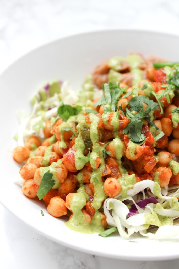 These Brown Rice Chickpea Taco Bowls with Jalapeño Cilantro Sauce are perfect for meal prep or an easy weeknight dinner   ThisSavoryVegan.com #thissavoryvegan #vegan #tacobowl