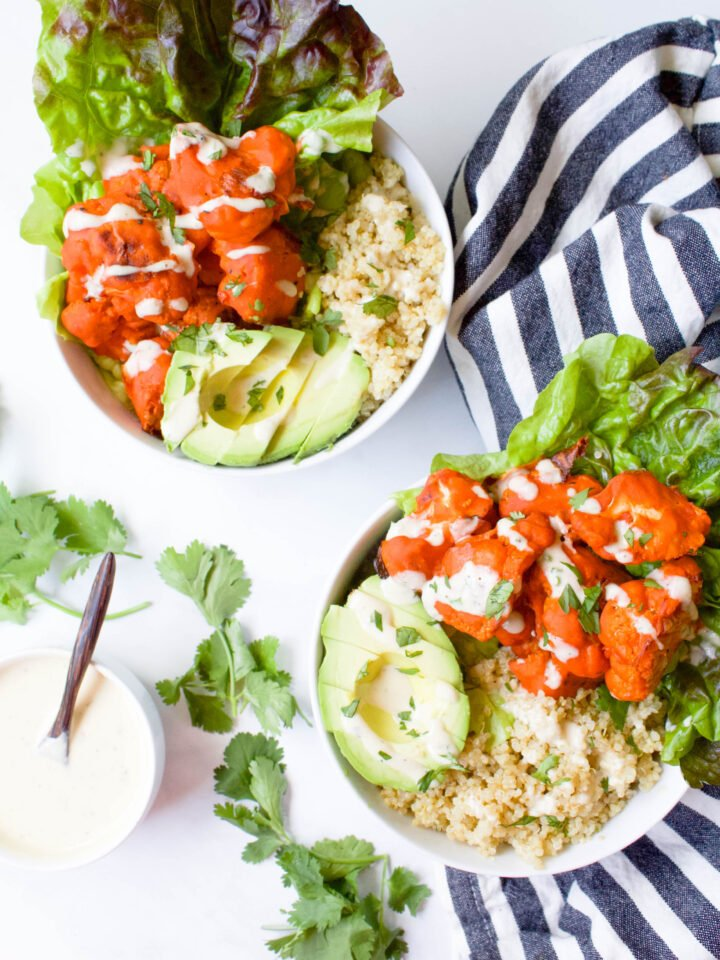 These Buffalo Cauliflower Quinoa Bowls with Vegan Tahini Ranch are the perfect healthy lunch or dinner. Great meal prep idea for busy weekdays | ThisSavoryVegan.com #thissavoryvegan #vegan #buffalocauliflower