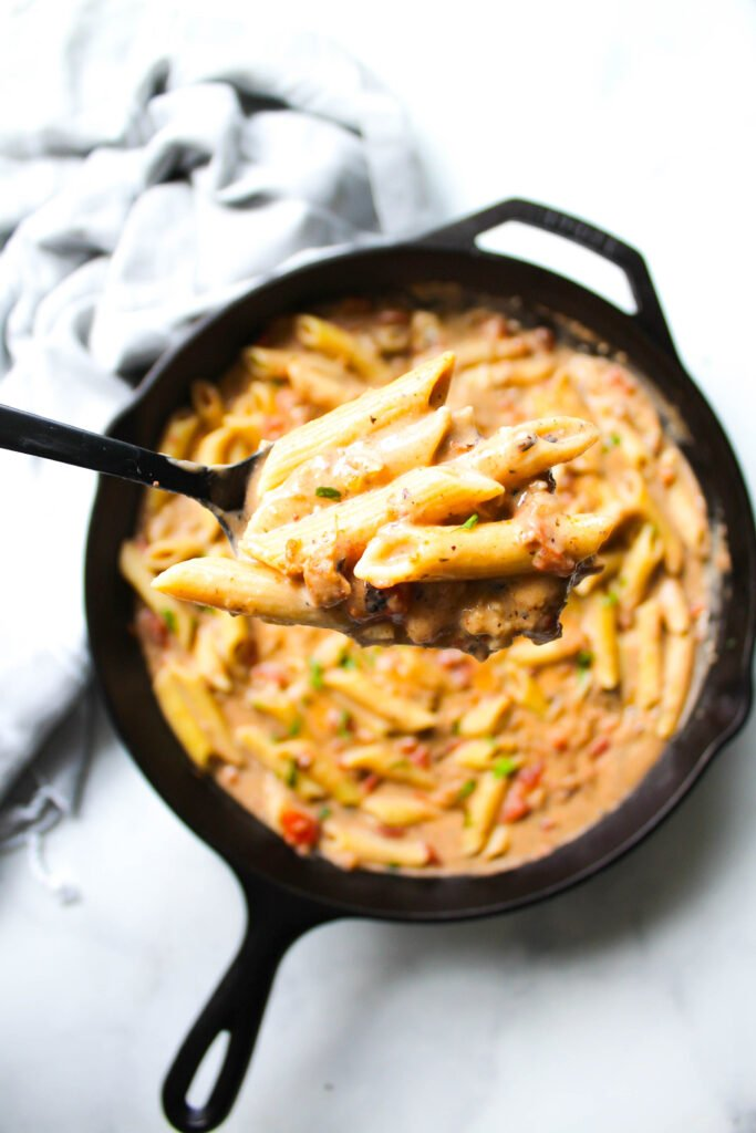 The perfect weeknight dinner, this Creamy Vegan Sausage & Pasta Skillet is ready in less than 30 minutes and requires just a few ingredients! | ThisSavoryVegan.com #thissavoryvegan #veganpasta #skilletmeal