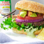 These Vegan Cajun Black Bean Burgers are loaded with a zesty patty, cajun aioli and an avocado salsa. The ultimate combo of flavors   ThisSavoryVegan.com #thissavoryvegan #veganburger #TonyChacheres #CreoleCanDo #ad