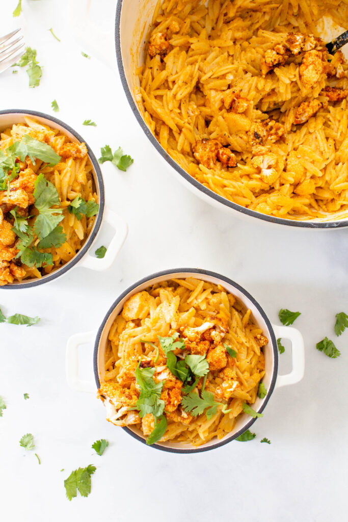 This Vegan Buffalo Cauliflower Orzo Mac and Cheese is creamy, dreamy comfort food. The perfect amount of spice to kick up this classic recipe   ThisSavoryVegan.com #thissavoryvegan #veganmacandcheese #buffalomacandcheese