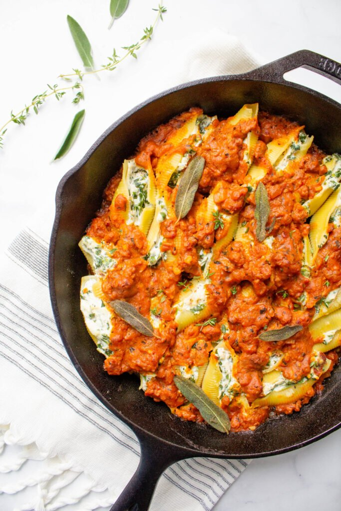 These Vegan Pumpkin and Sausage Stuffed Shells are filled with tofu ricotta and topped with fried sage. A simple and delicious vegan dinner!   ThisSavoryVegan.com #thissavoryvegan #vegan #veganpasta