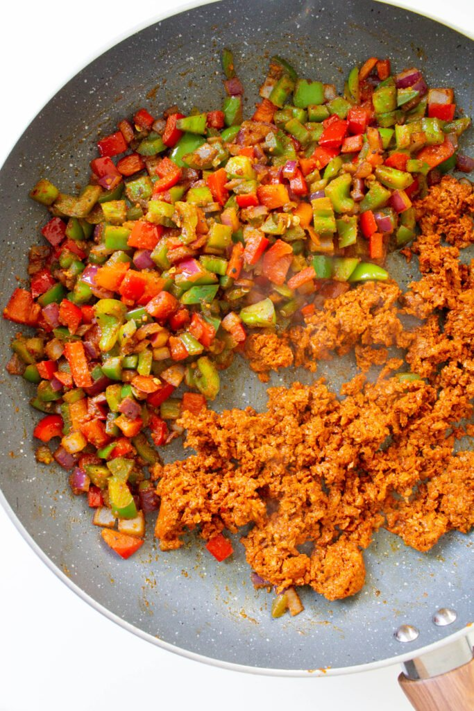 This Vegan Taco Pasta has all the flavor of traditional tacos, but in casserole form. This vegan dinner is packed with veggies, soyrizo and pasta shells   ThisSavoryVegan.com #thissavoryvegan #veganpasta #tacopasta