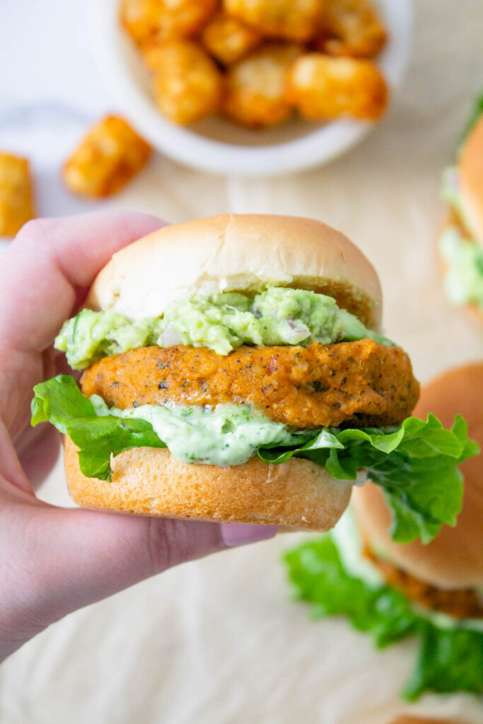 These Buffalo Chickpea Sliders with Vegan Basil Aioli are totally delicious! Whether you serve these at a party or for dinner, they are always a crowd pleaser | ThisSavoryVegan.com #thissavoryvegan #vegansliders #veganpartysnacks