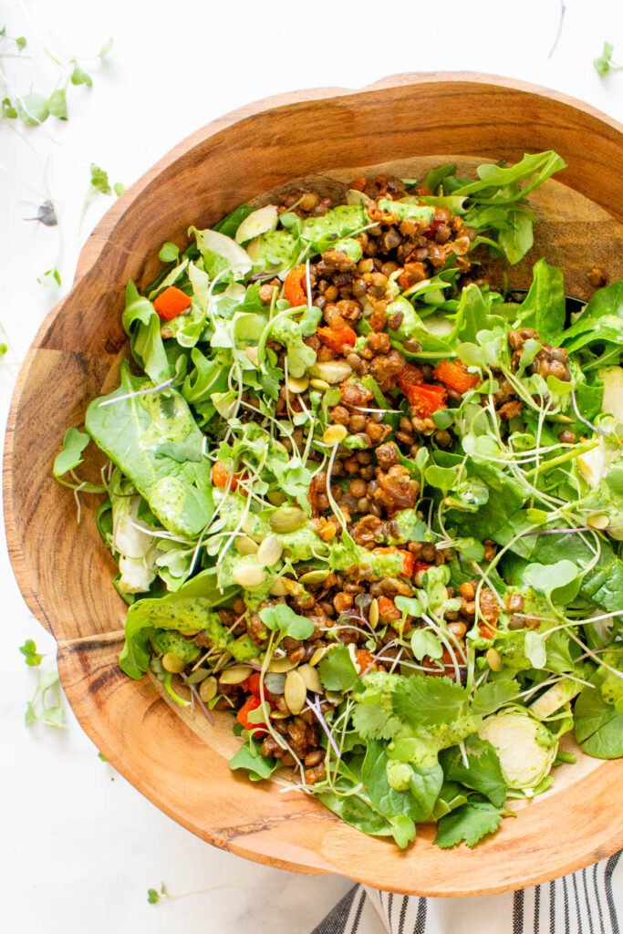 This Super Green Vegan Taco Salad is healthy, flavorful and packed with 4 kinds of greens, seasoned lentils and jalapeño cilantro dressing   ThisSavoryVegan.com #thissavoryvegan #vegan #tacosalad