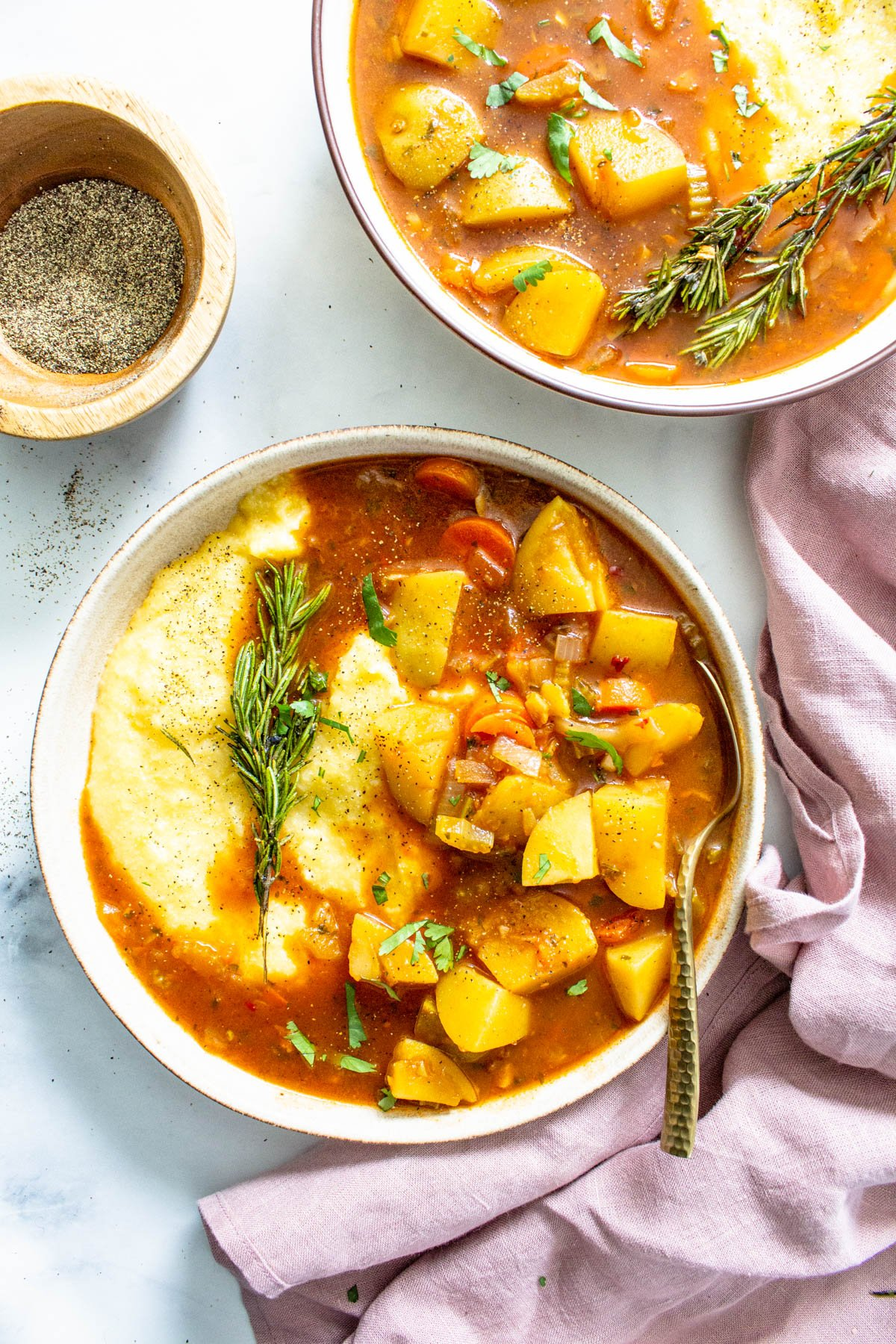 This Vegan Potato Stew with Rosemary Garlic Polenta is a simple dinner that packs tons of flavors and veggies into one easy to make meal   ThisSavoryVegan.com #thissavoryvegan #veganstew #veganpolenta