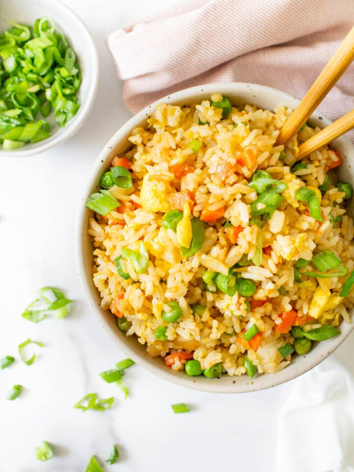 Vegan Fried Rice is not only super easy to make it is also SUPER tasty. With a few easy swaps you can have a better than take-out vegan meal at home   ThisSavoryVegan.com #thissavoryvegan #veganfriedrice