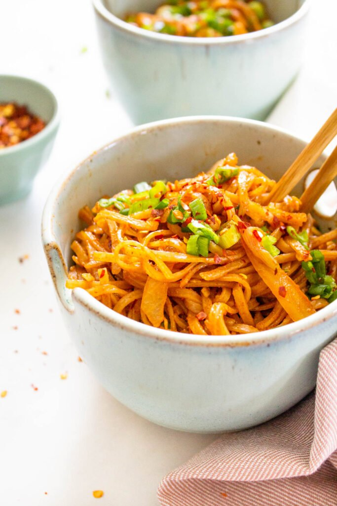 These Spicy Thai Noodles are quick, simple and totally mouthwatering. Bulk them up with extra veggies for a better than takeout vegan dinner at home   ThisSavoryVegan.com #thissavoryvegan #spicynoodles #vegannoodles