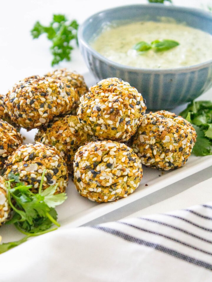 These Air Fryer Falafel Bites with Pesto Dipping Sauce are the perfect vegan snack - covered in everything but the bagel seasoning and perfectly crispy | ThisSavoryVegan.com #thissavoryvegan #falafel #vegansnacks