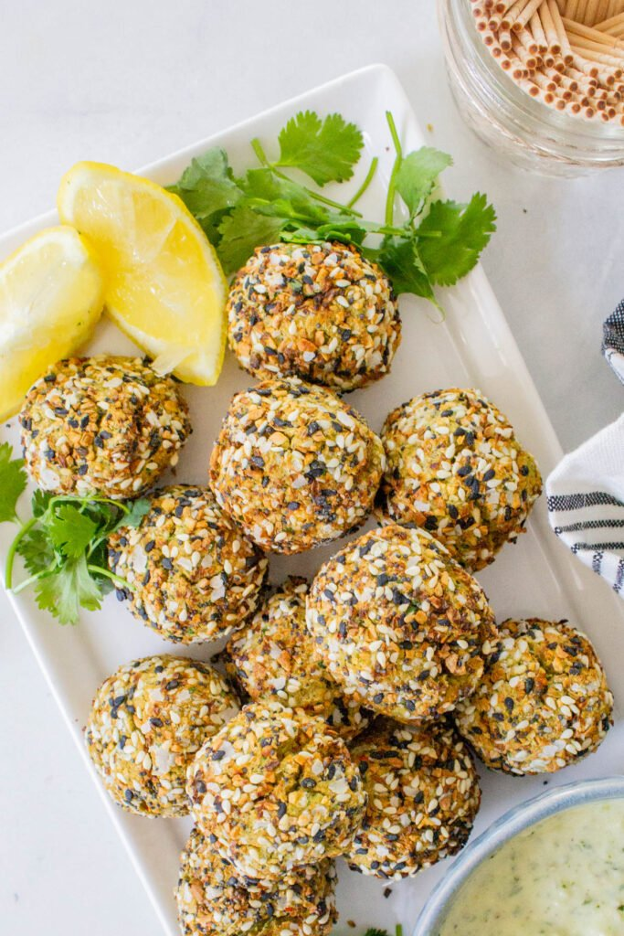 These Air Fryer Falafel Bites with Pesto Dipping Sauce are the perfect vegan snack - covered in everything but the bagel seasoning and perfectly crispy   ThisSavoryVegan.com #thissavoryvegan #falafel #vegansnacks