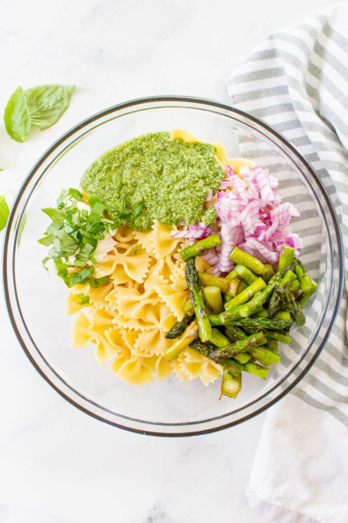 This Grilled Asparagus Pasta Salad is the perfect side dish for your next vegan BBQ. Homemade vegan pesto, crisp asparagus and chilled pasta   ThisSavoryVegan.com #thissavoryvegan #veganpastasalad #pestopastasalad
