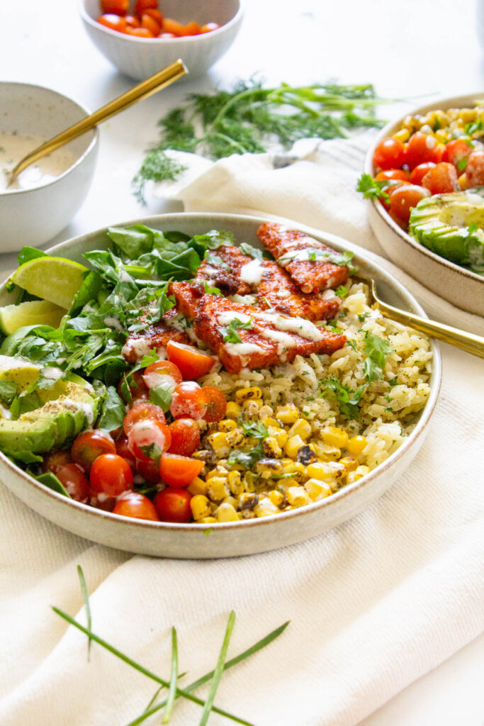 These BBQ Tempeh Bowls with Garlic Herb Rice are loaded with flavor-packed rice, corn, tomatoes, greens, crispy tempeh and vegan dressing. Perfect for meal prepping | ThisSavoryVegan.com #thissavoryvegan #veganbowls #bbqtempeh