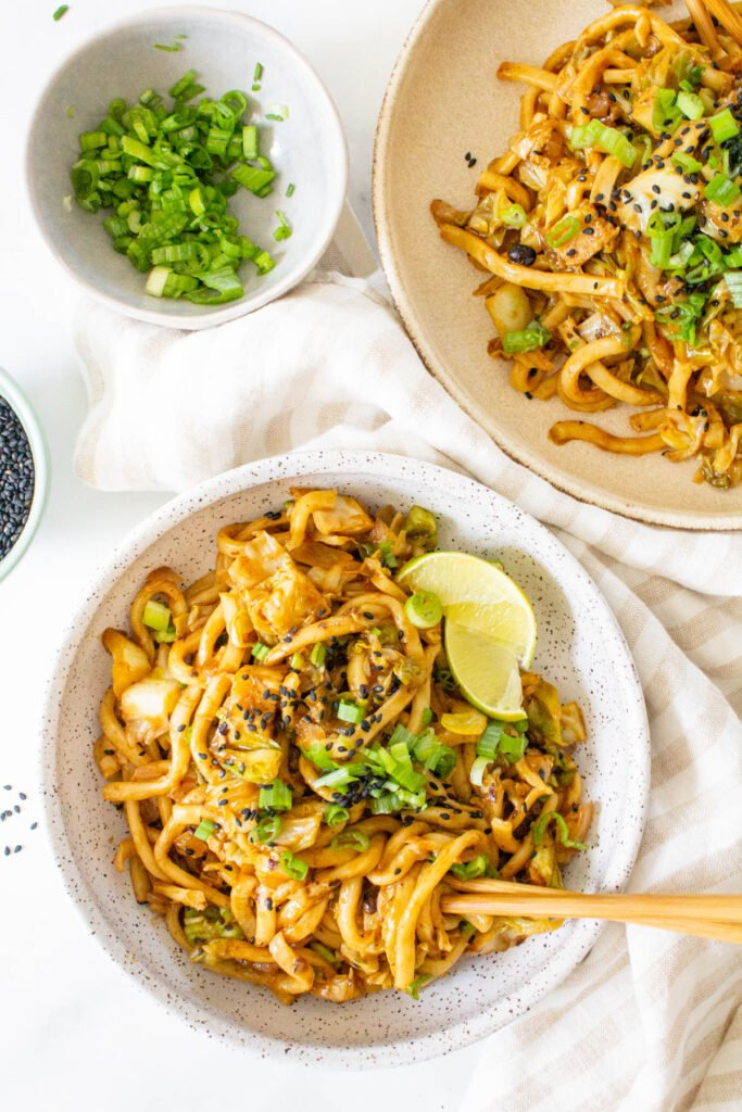 This Vegan Udon Noodle Cabbage Stir Fry is a quick weeknight dinner that is better than take-out. Ready in less than 30 minutes   ThisSavoryVegan.com #thissavoryvegan #veganstirfry #udon