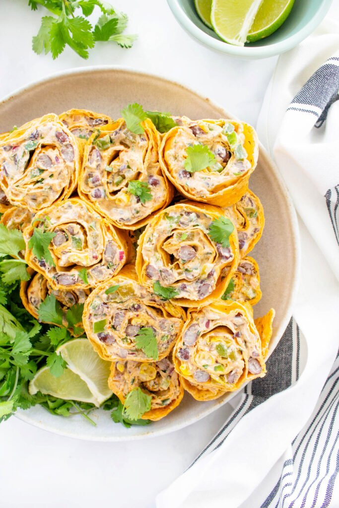 These Simple Vegan Taco Pinwheels are the perfect party appetizer, make ahead lunch or easy snack. No need to cook when you can eat a pinwheel instead | ThisSavoryVegan.com #thissavoryvegan #veganwrap #veganpinwheels