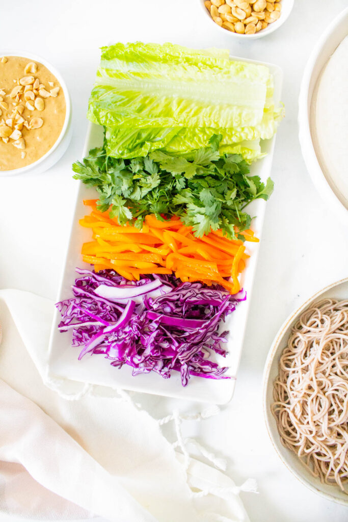 These Soba Noodle Summer Roles with Peanut Sauce are the perfect no-cook meal. Fresh veggies, fiber-packed soba noodles and a creamy peanut sauce. A great vegan lunch or dinner   ThisSavoryVegan.com #thissavoryvegan #summerroles #peanutsauce