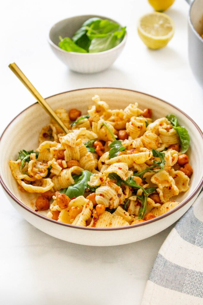 This Spicy Vegan Garlic Pasta with Roasted Chickpeas is the ultimate quick vegan dinner. Simple ingredients in a light & spicy garlicky sauce | ThisSavoryVegan.com #thissavoryvegan #veganpasta #chickpeas