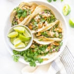These Vegan Lemon Pepper Chicken Tacos are loaded with a kale avocado slaw and a chili lime crema. Perfect for your next Taco Tuesday   ThisSavoryVegan.com #thissavoryvegan #vegantacos #lemonpepperchicken