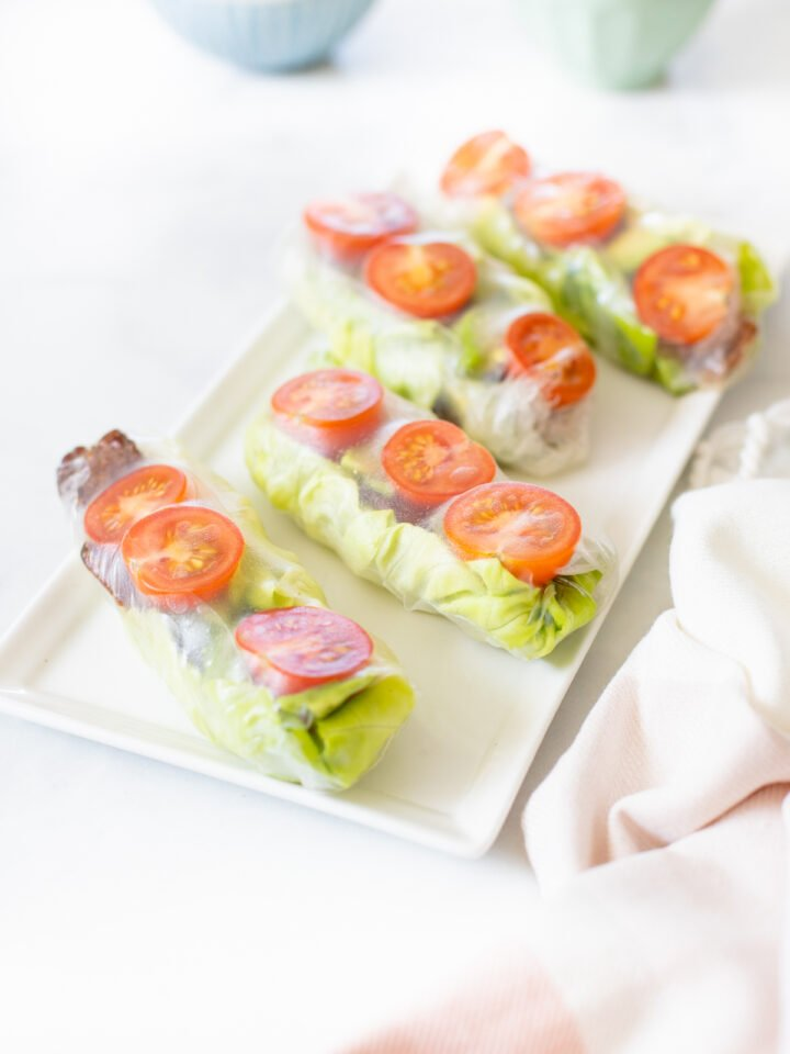 These Vegan BLT Summer Rolls are the perfect cold lunch or snack. Loaded with tempeh bacon, cherry tomatoes, butter lettuce & avocado. Served with Vegan Cilantro Ranch | ThisSavoryVegan.com #thissavoryvegan #summerrolls #veganblt