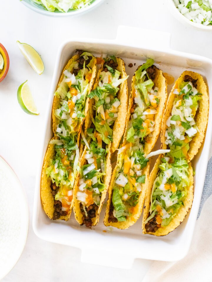 """These Vegan Oven Baked Tacos are the perfect weeknight dinner. Crispy taco shells are loaded with lentil taco """"meat"""" and vegan queso 