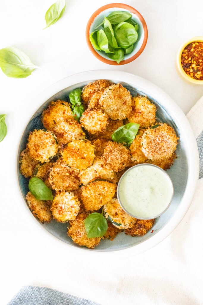 These Air Fryer Zucchini Chips with Vegan Basil Aioli are the best snack idea! They are crispy, flavor-packed and a healthier version of chips   ThisSavoryVegan.com #thissavoryvegan #airfryerrecipe #zucchinirecipes