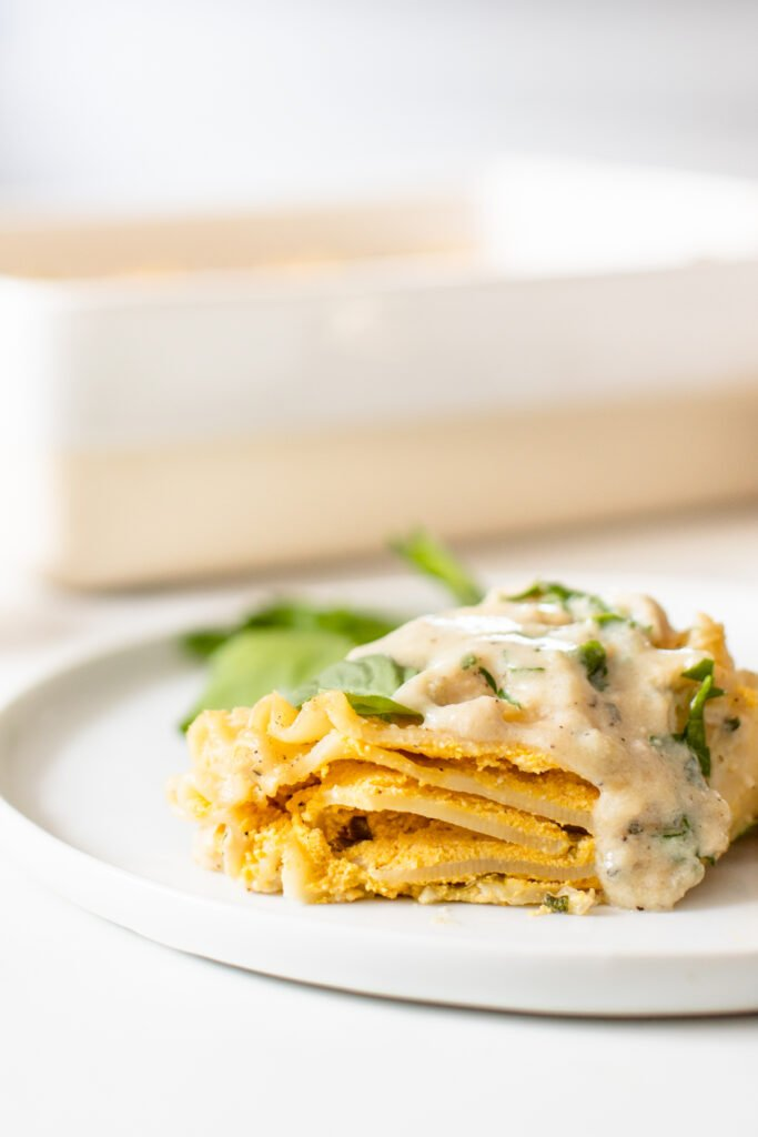 These Vegan Pumpkin Lasagna Roll Ups are filled with vegan ricotta, fresh herbs & pumpkin before being topped with a creamy vegan sauce! Perfect dinner for a cold night   ThisSavoryVegan.com #thissavoryvegan #veganlasagna #pumpkinlasagna