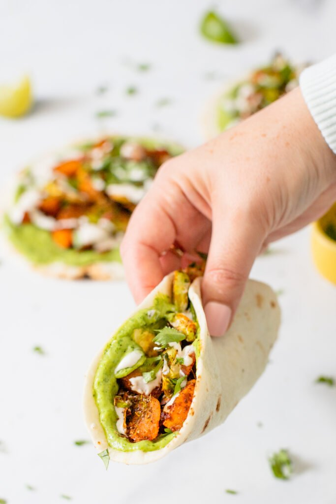 These Vegan Butternut Squash Tacos with Crispy Brussels Sprouts are loaded with flavor - from the avocado spread to the lime crema. Perfect Fall tacos! | ThisSavoryVegan.com #thissavoryvegan #vegantacos #butternutsquash
