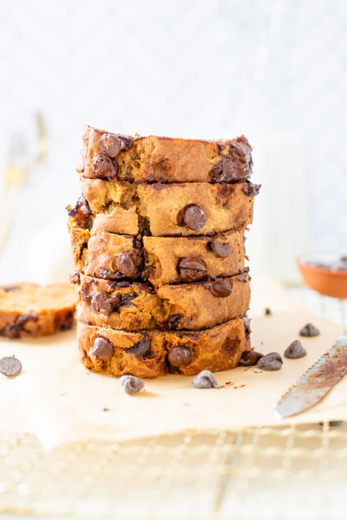 This Vegan Pumpkin Banana Bread is the perfect breakfast or snack. It is sweetened naturally with maple syrup and made extra tasty with chocolate chips   ThisSavoryVegan.com #thissavoryvegan #veganpumpkinbread #pumpkinbananabread