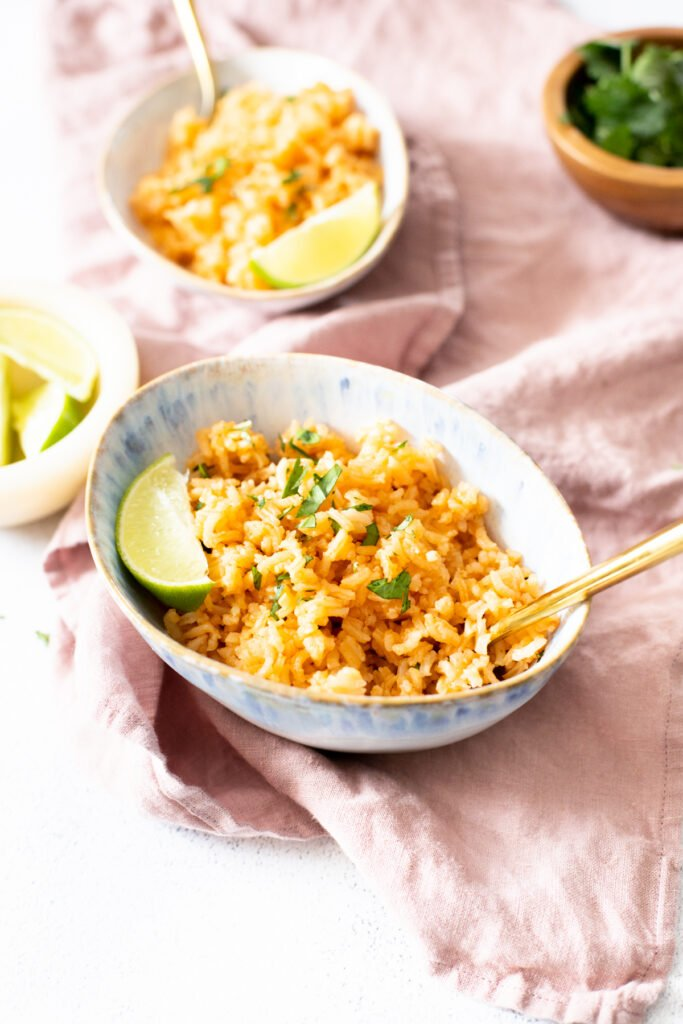This Simple Vegan Mexican Rice is made with simple ingredients and tastes just like authentic Mexican rice from a restaurant. Perfect side dish   ThisSavoryVegan.com #thissavoryvegan #mexicanrice #vegansidedish